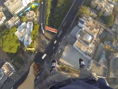 Fearless climber James Kingston is back… watch him on top of a crane in India