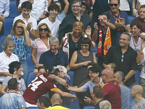 Roma's Alessandro Florenzi celebrates scoring against Cagliari by running into the crowd and hugging his grandmother