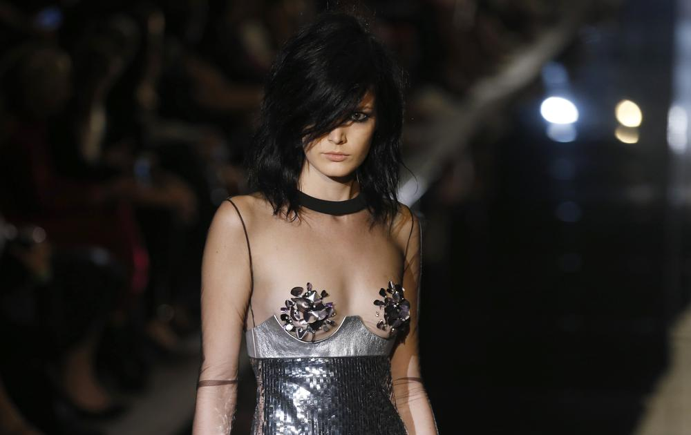 LFW SS15: Tom Ford's sexy 70s glam rock show introduces capes and nipple pasties for evening