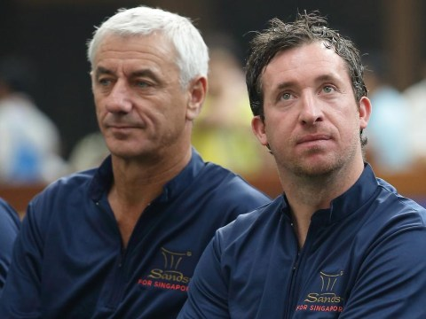 Liverpool legends Robbie Fowler and Ian Rush check in Gatwick Airport passengers for Garuda Indonesia airline