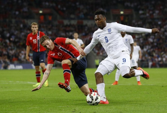 England's Daniel Sturridge, right, vies for the ball with Norway's Stefan Johansen during the international friendly soccer match between England and Norway at Wembley Stadium in London, Wednesday, Sept. 3, 2014. (AP Photo/Kirsty Wigglesworth) AP Photo/Kirsty Wigglesworth