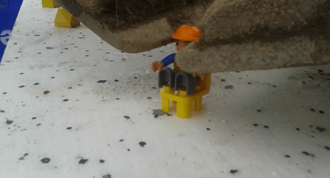 Dig this guy's Lego skills: Man uses massive excavator to build toy truck