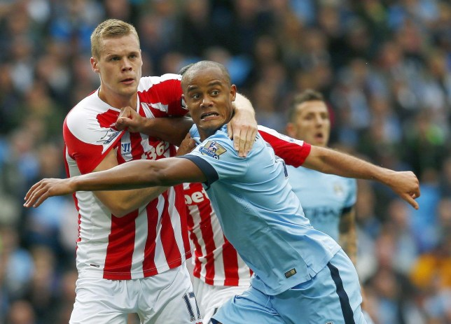 "Manchester City's Vincent Kompany (R) is challenged by Stoke City's Ryan Shawcross during their English Premier League soccer match at the Etihad stadium in Manchester, northern England August 30, 2014. REUTERS/Eddie Keogh (BRITAIN - Tags: SPORT SOCCER) NO USE WITH UNAUTHORIZED AUDIO, VIDEO, DATA, FIXTURE LISTS, CLUB/LEAGUE LOGOS OR ""LIVE"" SERVICES. ONLINE IN-MATCH USE LIMITED TO 45 IMAGES, NO VIDEO EMULATION. NO USE IN BETTING, GAMES OR SINGLE CLUB/LEAGUE/PLAYER PUBLICATIONS. FOR EDITORIAL USE ONLY. NOT FOR SALE FOR MARKETING OR ADVERTISING CAMPAIGNS Eddie Keogh/Reuters"