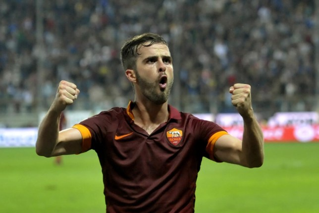 Roma's Miralem Pjanic celebrates after scoring during a Serie A soccer match against Parma, at Parma's Tardini stadium, Italy, Wednesday, Sept. 24, 2014. (AP Photo/Marco Vasini) AP Photo/Marco Vasini