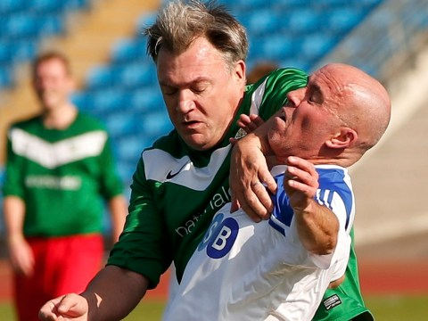 Ouch: Ed Balls' 'strong arm tactics' in Labour Party MP's v lobby journalists football match