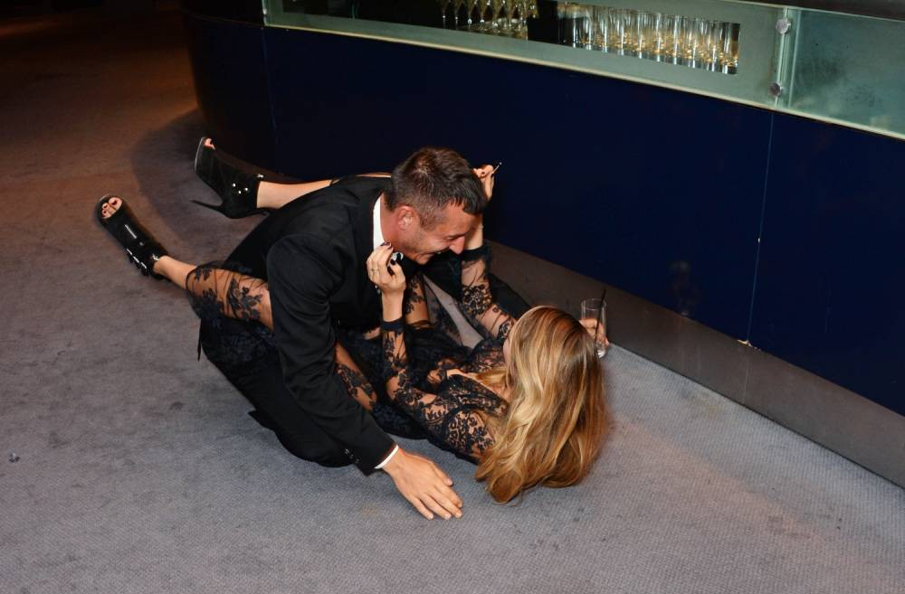 Cara Delevingne goes from ladylike to legs in the air as she suffers a major tumble at GQ Awards