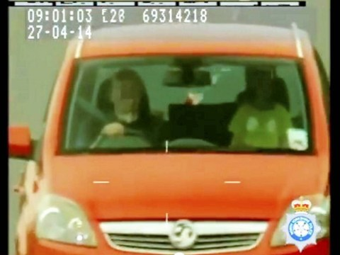 Grandfather of the year lights a cig while speeding, with his grandson standing on the passenger seat
