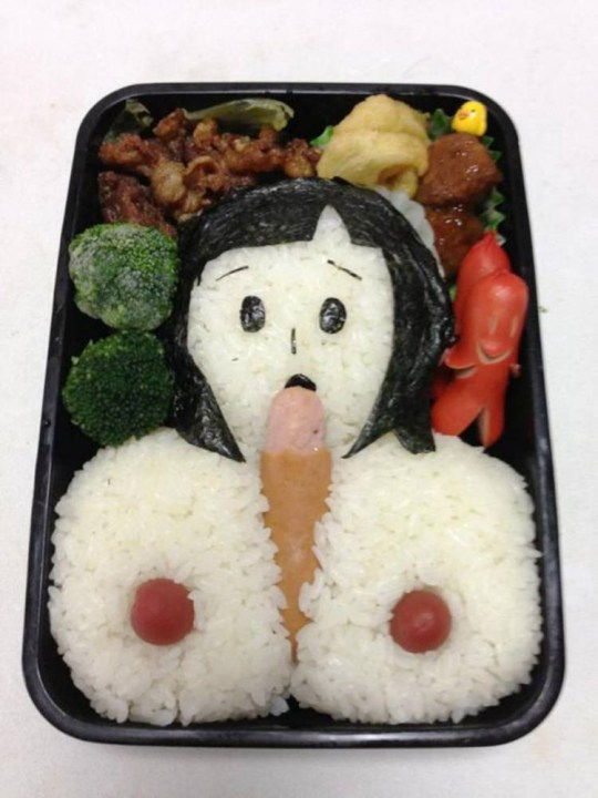 """Pic shows: Woman Motoko Taketou created his husband a specially modified pornographic Bento box for lunch as revenge.nnA Japanese woman fed up with her husband staying up until late at night looking at porn on the computer is likely to get a rude awakening when he opens this lunchbox.nnMotoko Taketou reportedly clashed with husband Sakutarou frequently after he spent hours in the evening looking for sites instead of spending time with her.nnIt also made him tired and late for work and she complained that he wasn't taking his career seriously.nnSo after another late-night session, knowing that her husband would be tired and not paying attention in the morning, she created him a specially modified pornographic Bento box for lunch.nnShe then posted on Twitter saying: """"I wonder how my husband will explain this to colleagues.""""nnBento is a single-portion takeout or home-packed meal common in Japanese cuisine. A traditional bento holds rice, fish or meat, with pickled or cooked vegetables, usually in a box-shaped container. Japanese were will often make Bento boxes for children or husbands, although not usually with such creativity.nnThis particular Bento box image ended up going viral in Japan, including the woman's comment that she hadn't had time to make the fried eggs. She didn't specify how they would have fitted into the artwork.nn(ends)n"""