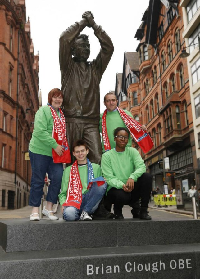 Handout photo provided by Capital One of Nottingham Forest fans in Brian Clough style green jumpers during a photocall in Nottingham city centre. PRESS ASSOCIATION Photo. Issue date: Thursday September 18, 2014. Capital One is honoring football legend Brian Clough in Nottingham Forestís Capital One Cup tie against Spurs on Wednesday, September 24 by giving away 1,000 replicas of his famous fashion accessory - a green round neck jumper. See PA story SOCCER Clough. Photo credit should read: Capital One/PA Wire. NOTE TO EDITORS: This handout photo may only be used in for editorial reporting purposes for the contemporaneous illustration of events, things or the people in the image or facts mentioned in the caption. Reuse of the picture may require further permission from the copyright holder.
