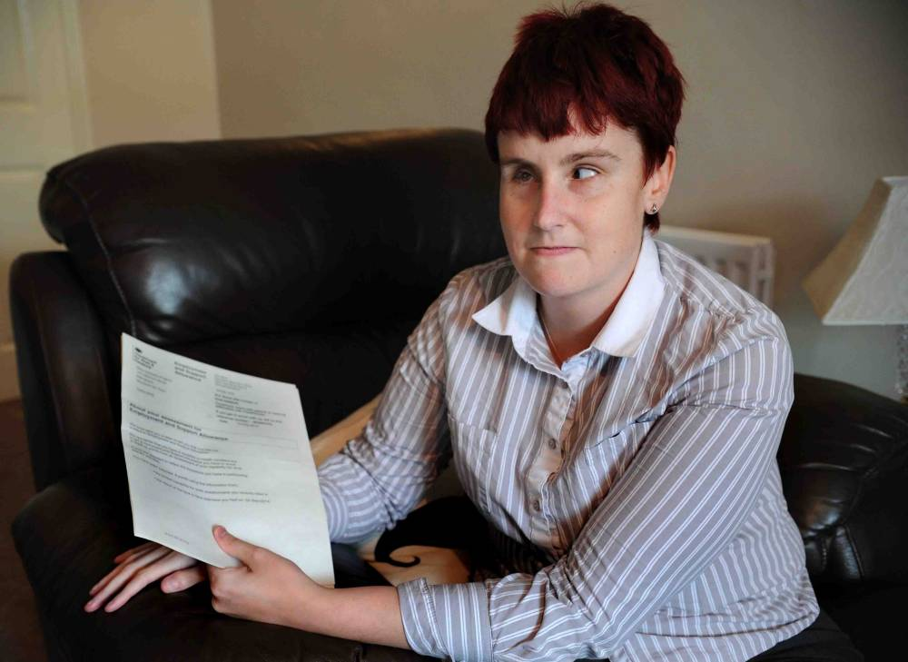 A blind woman said she will fight to have her benefits reinstated after being told to get a job.nNatasha Pogson was called up to a controversial ¿fit-to-work¿ assessment ¿ part of the government¿s overhaul of the welfare system.nThe 28-year-old was born blind as a result of being premature - arriving at 26 weeks and weighing just 1lb 11oz.nBut an assessor ruled she was not eligible for help and told her she must actively look for work through Jobseekers Allowance (JSA).nNatasha¿s previous benefits amounted to £162 a week under the disability allowance scheme but this will fall to £72.40 under JSA.nNatasha is in the process of appealing against the decision and slammed the system for making her feel like a benefits cheat.nnNatasha Pogson of Billingham, she is blind and has had her disablity allowance revoked, pictured with guide dog 'Vince'.Teesside. 17.09.14.