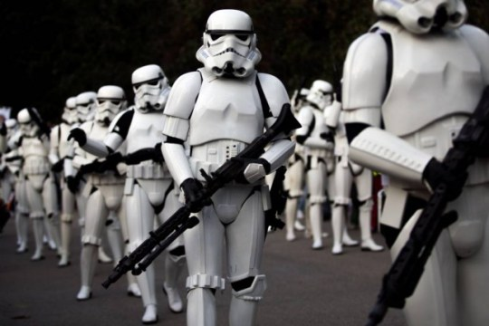 Revelers dressed as stormtroopers of the Galactic Empire march during a Star Wars Parade in Madrid, Spain, Saturday, Sept. 20, 2014. (AP Photo/Andres Kudacki)