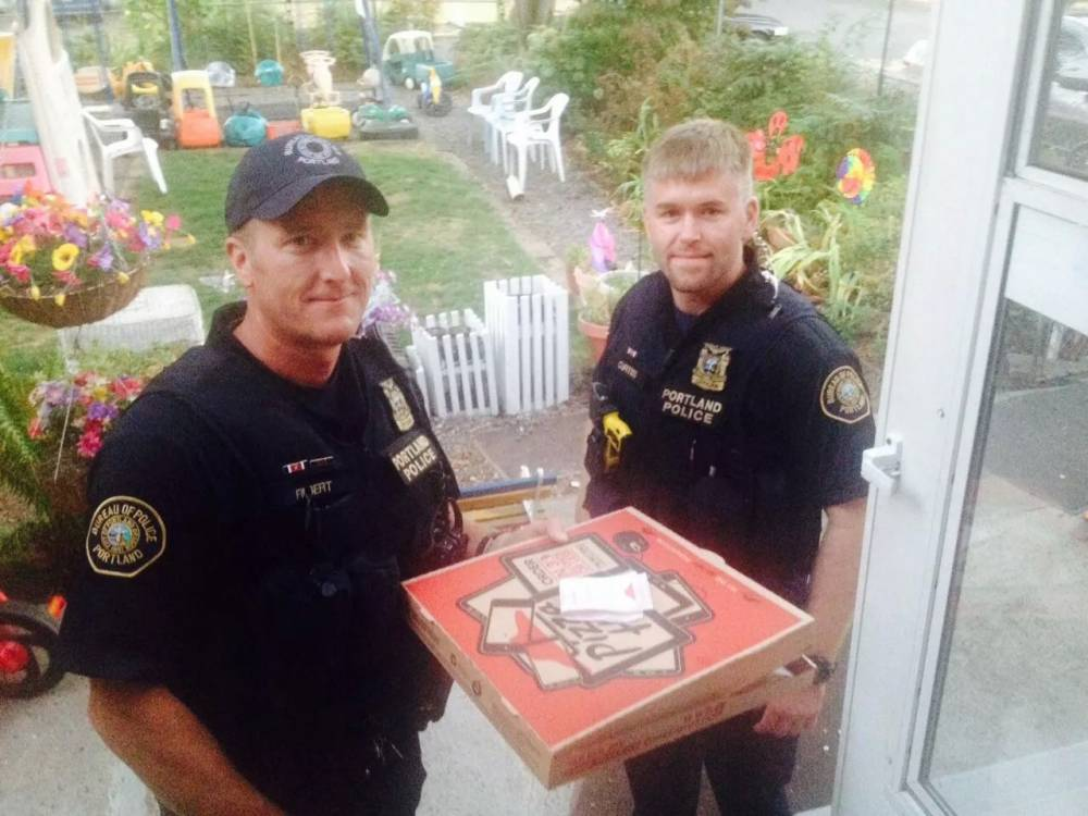 Police officers deliver takeaway, after Pizza Hut driver is in a motorbike accident