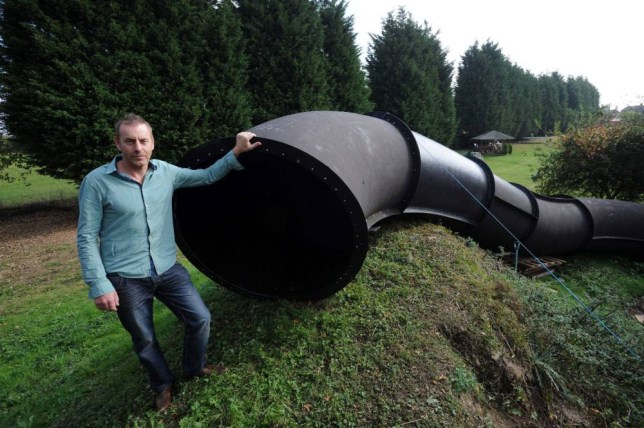 A FUN-LOVING family have snapped up a 130ft council water flume ¿ and set it up in their back GARDEN...Paul Betts didn¿t hesitate when he saw the monster slide being taken down bit by bit at Bury St Edmunds Leisure Centre in Suffolk...And when his thrilled family gave him the thumbs-up he forked out the grand sum of £50 and trucked it home...The Betts have since been busily installing the giant chute in their sprawling 325ft garden in Stonham Aspal after carting it 25 miles across country in lorry loads...My new toy - Paul with his enormous slide.