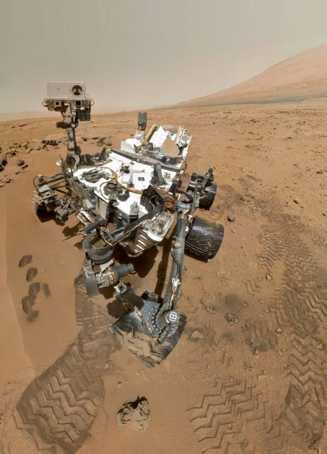 "The Mars rover Curiosity. See SWNS story SWMARS; Space enthusiasts watching the Mars rover roam the surface of the red planet were stopped in their tracks after the explorer spotted -- a TRAFFIC LIGHT. Nasa has been beaming photos from space since their mobile robot Curiosity landed on the 'red' planet in August 2012. Keen-eyed Joe Smith, 45, noticed a chuck of rock in the corner of footage which looks bizarrely like a set of traffic lights. Joe, a space video journalist, from Bristol, said: ""I have been following the images from Nasa since the start and I flick through them on the Nasa website every day."