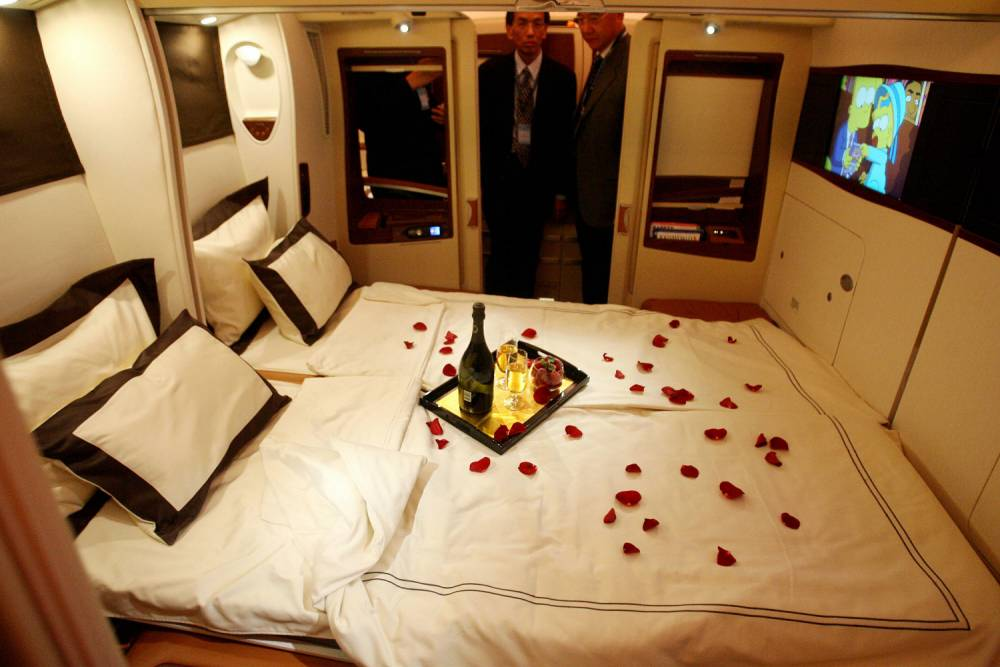 Singapore Airlines suites, a first class seat bed with door on board the first Airbus A380 superjumbo which arrived at the Changi International Airport in Singapore 17 October 2007.  The first Airbus A380 superjumbo landed in Singapore, as the countdown began for next week's maiden commercial flight of the biggest passenger airliner ever built. AFP PHOTO/ROSLAN RAHMAN (Photo credit should read ROSLAN RAHMAN/AFP/Getty Images)