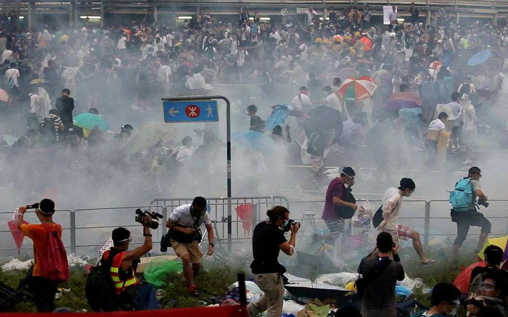 Police fire tear gas on thousands of pro-democracy protesters in Hong Kong