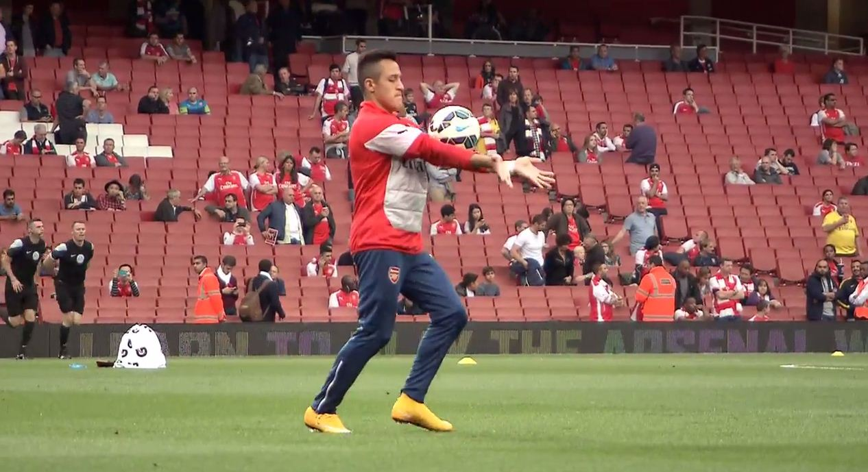 Alexis Sanchez shows off his skills during Arsenal warm-up for Tottenham clash