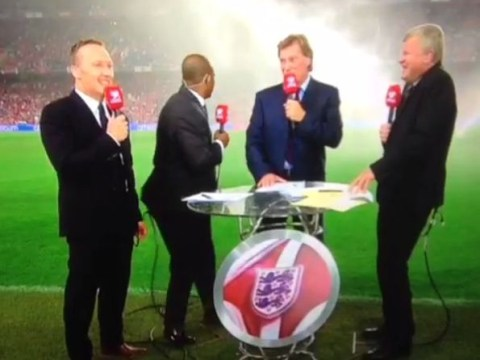ITV pundits Adrian Chiles, Glenn Hoddle, Ian Wright and Lee Dixon get soaked by pitch sprinklers before England game