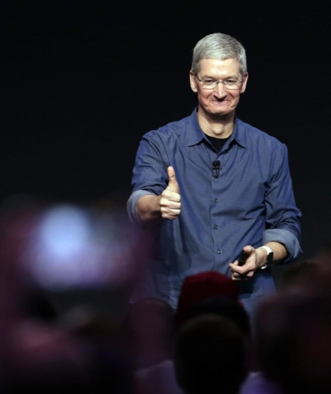 Tim Cook unveils Apple's latest innovation: an invisible iPad. No, not really. (Picture: AP Photo/Marcio Jose Sanchez)