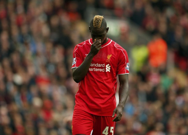 Liverpool's Mario Balotelli reacts during their English Premier League soccer match against Hull City at Anfield in Liverpool, northern England October 25, 2014. REUTERS/Phil Noble (BRITAIN - Tags: SOCCER SPORT) EDITORIAL USE ONLY. NO USE WITH UNAUTHORIZED AUDIO, VIDEO, DATA, FIXTURE LISTS, CLUB/LEAGUE LOGOS OR 'LIVE' SERVICES. ONLINE IN-MATCH USE LIMITED TO 45 IMAGES, NO VIDEO EMULATION. NO USE IN BETTING, GAMES OR SINGLE CLUB/LEAGUE/PLAYER PUBLICATIONS.FOR EDITORIAL USE ONLY. NOT FOR SALE FOR MARKETING OR ADVERTISING CAMPAIGNS. Phil Noble/Reuters