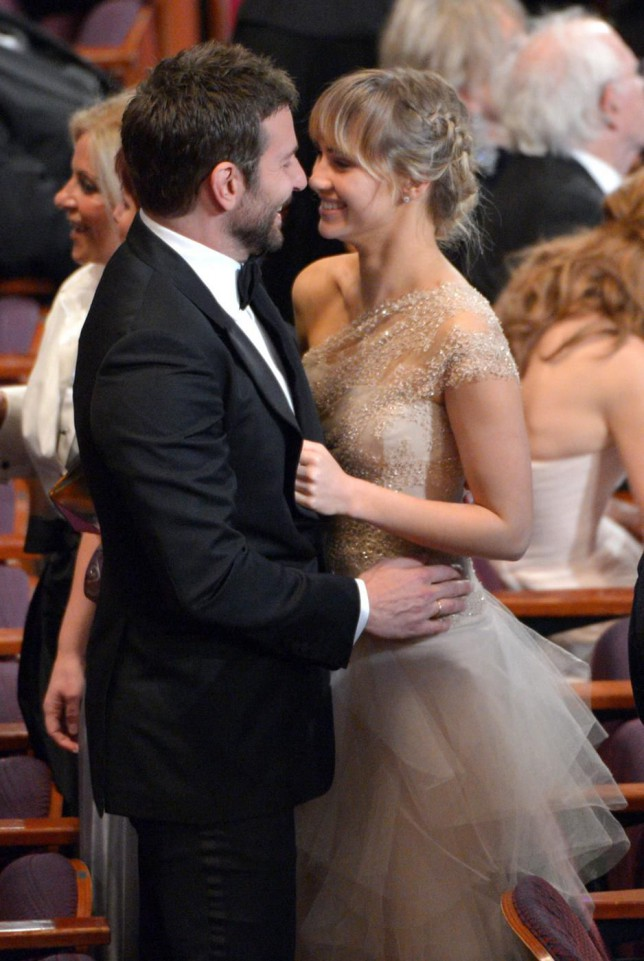 Bradley Cooper, left, and Suki Waterhouse appear in the audience at the Oscars at the Dolby Theatre on Sunday, March 2, 2014, in Los Angeles. (Photo by John Shearer/Invision/AP) John Shearer/Invision/AP