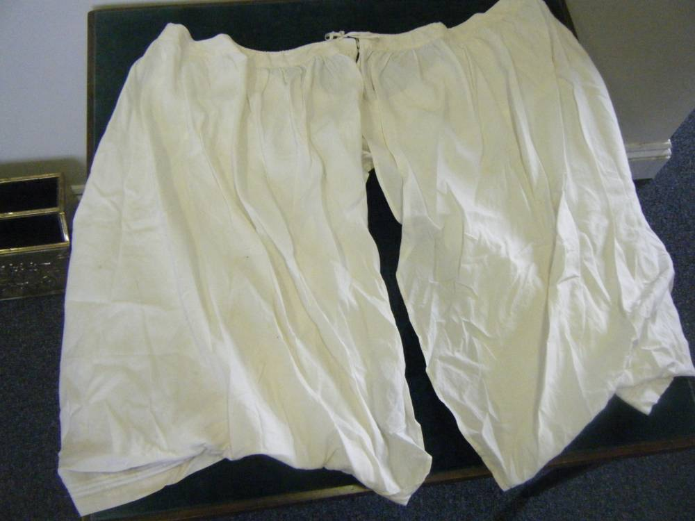 We are not amusedÖÖ A lucky collector with the nose to sniff out a bargain could snap up a pair of 100-year-old silk bloomers ñ once worn by QUEEN VICTORIA. See swns story SWQUEEN. Famed for her voluptuous Royal rear and bumper bosoms, a matching set of 52-inch waist bloomers and a 66-inch bust chemise are going under the hammer at auction next week. The size 36 ësmallsí ñ which are embroidered with the long-reigning monarchís crest, are expected to reach in excess of £2000 when they go under the hammer at Westernhanger Auctioneers on Sunday, October 12. The 19th Century silk undergarments were gifted to a member of staff at the Royal household by the Queen herself, as thanks for long service.