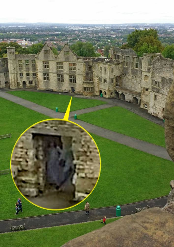 PIC BY AMY HARPER / CATERS NEWS - (PICTURED: The ghostly figure in the castle) - A chilling figure of a ghostly woman in grey has been caught on camera on a day trip to a castle. Amy Harper, from Birmingham, West Mids snapped a selection of pictures of the Sharington Range Tudor palace, while visting Dudley Castle, but couldnt believe it when she spotted a ghostly figure of a woman in one of the archways. Amy, who took the spooky snap on her Samsung Galaxy camera phone, believes the blurred figure of a woman she caught on camera could be that of a ghost called the Grey Lady, who has haunted the castle for centuries. SEE CATERS COPY.