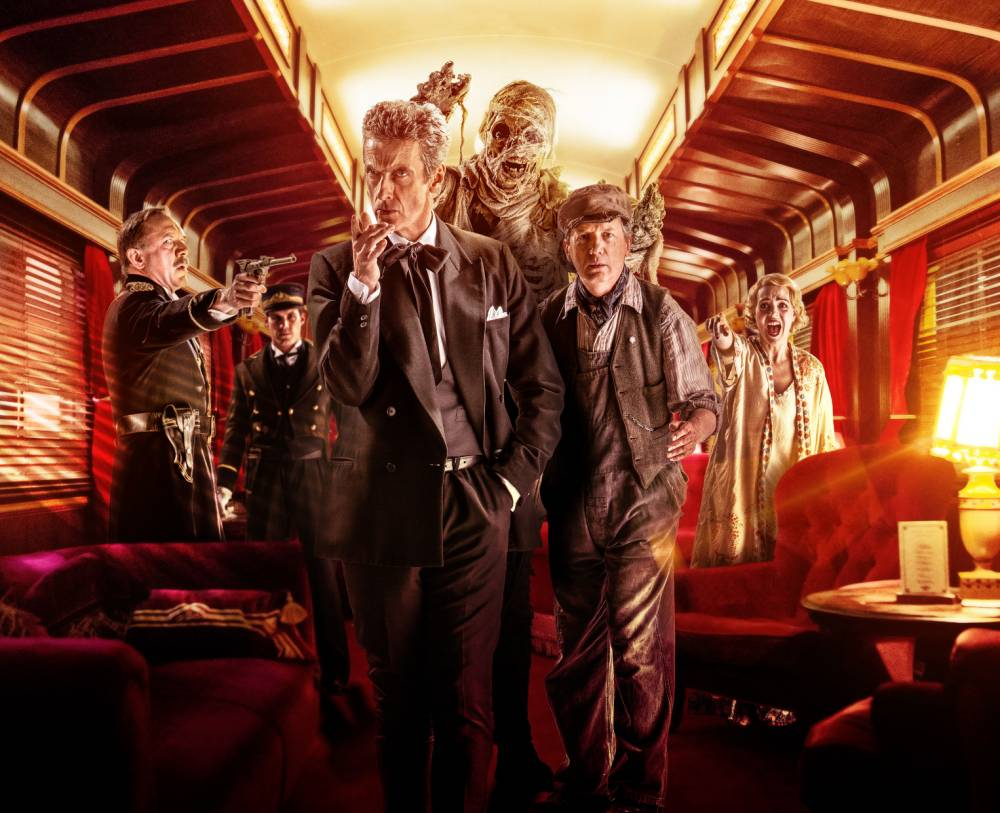 For use in UK, Ireland or Benelux countries only. BBC undated handout photo of Perkins played by Frank Skinner (second right) with The Doctor played by Peter Capaldi (centre left) as Skinner has said he has been worried his guest performance on tomorrow night's edition of Doctor Who may not be up to scratch. PRESS ASSOCIATION Photo. Issue date date: Friday October 10, 2014. The Absolute Radio presenter said he was so excited to be asked to be in the BBC1 show that he did not consider whether he would be any good in the role. Skinner plays a character called Perkins in the show, set aboard an Orient Express-style craft which travels through space. See PA story SHOWBIZ DoctorWho. Photo credit should read: Adrian Rogers/BBC/PA Wire NOTE TO EDITORS: Not for use more than 21 days after issue. You may use this picture without charge only for the purpose of publicising or reporting on current BBC programming, personnel or other BBC output or activity within 21 days of issue. Any use after that time MUST be cleared through BBC Picture Publicity. Please credit the image to the BBC and any named photographer or independent programme maker, as described in the caption.