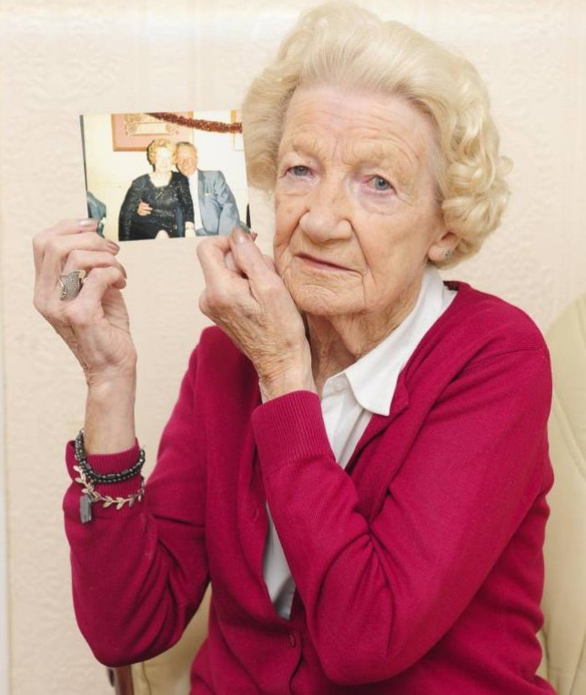 Jean Gittins with a picture of her husband Dennis