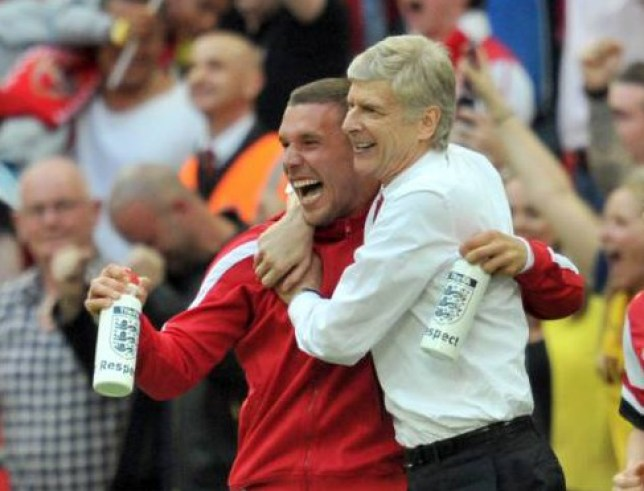 Arsenal's French manager Arsene Wenger (C) celebrates with Arsenal's Polish-born German striker Lukas Podolski after winning the English FA Cup final match against Hull City at Wembly Stadium in London on May 17, 2014. Aaron Ramsey scored an extra-time winner as Arsenal ended their nine-year trophy drought by coming from two goals down to beat Hull City 3-2 in a gripping FA Cup final. AFP PHOTO/GLYN KIRK  == NOT FOR MARKETING OR ADVERTISING USE / RESTRICTED TO EDITORIAL USE ==        (Photo credit should read GLYN KIRK/AFP/Getty Images)