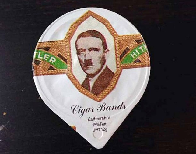 """Pic shows: Plastic takeout cream coffee cream shows the face of Hitler.nnCoffee cream lids showing the faces of Hitler and Mussolini caused outrage after being handed out to punters in Switzerland.nnThe plastic takeout cream pot lids showing the fascist dictators portraits inside gold framing and distributed by Switzerland¿s largest supermarket chain Migros, were first spotted by a group of German businessmen having a coffee break in a local cafe in the city of Coire, in the eastern Swiss region of Graubunden.nnDisgusted German Christian Shuster, 47, who was on a business trip in Switzerland said: """"Our Swiss colleagues took us down to the coffee shop and when the waitress brought them over we saw the face of Hitler staring up at us from one of the cream containers.nn""""I couldn¿t believe it and at first thought it was some sort of sick joke being played by my colleagues.nn""""But then we saw the other containers also had the face of Hitler on and some had Mussolini.nn""""This is just absolutely evil and outrageous.""""nnThe cream lids were also found at a take away food kiosk in Switzerland¿s northern Aargau region.nnShocked punters flooded the kiosk owner with complaints after he handed them out with the takeaway coffees.nnKiosk owner Albert Erni, 33, said: """"To be honest, I hadn¿t even looked at them so when people started complaining I wasn¿t sure what they were talking about.nn""""But then I looked and, yes, was pretty shocked too.nn""""It seems like a very bizarre and distasteful piece of marketing.""""nnIn coffee-loving Switzerland, labels from the mini-cream containers are cult collectibles, and producers often seek new and inventive ways to enhance their appeal.nnTristan Cerf, a spokesman for Migros, said the mishap had occurred when an outside company asked ELSA, a dairy manufacturer and Migros subsidiary, to supply a series of 55 coffee cream containers based on vintage cigar labels, two of which featured the dictators.nnHe said that the outside company had provided the contro"""