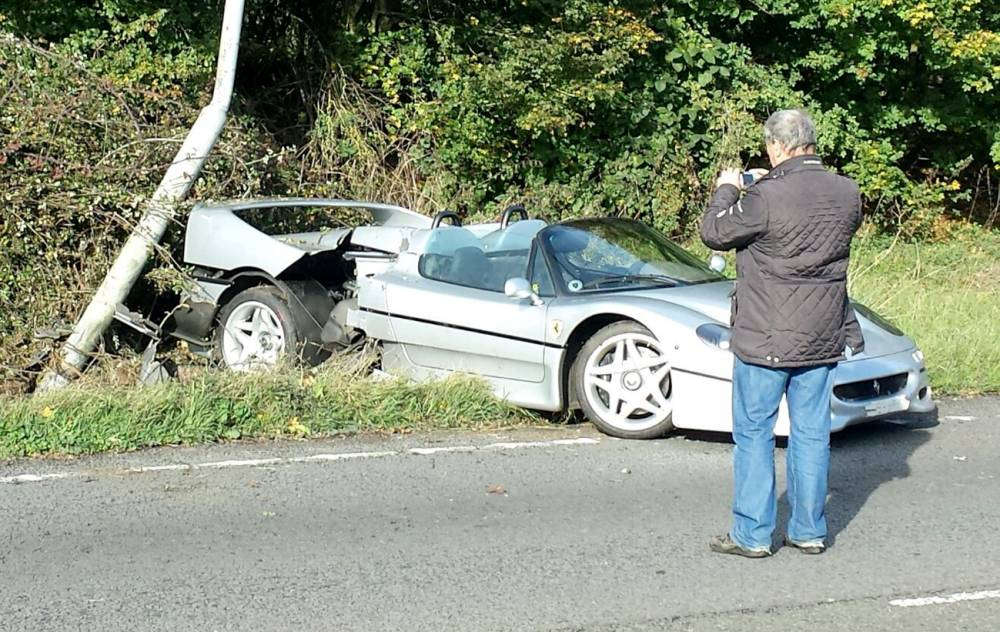 This very rare Ferrari supercar has been badly damaged in one of the UKís most expensive single-car crashes. The Ferrari F50 - one of just 349 and worth around £850,000 - hit a lamppost after the driver came off a roundabout. See SWNS story SWFERRARI; It appears to suffered serious damage to the rear-half, near where the supercarís V12 engine is located. The crash happened near Silverstone in Northamptonshire on Wednesday morning.