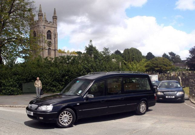 PLYMPTON, ENGLAND - JUNE 08:  The hearse carrying the coffin of Robert Daley leaves St. Mary's Church on June 8, 2011 in Plympton, England. British diving champion Tom Daley's father, Rob, who was 40, died on 27 May after a long battle with brain cancer.  (Photo by Matt Cardy/Getty Images)