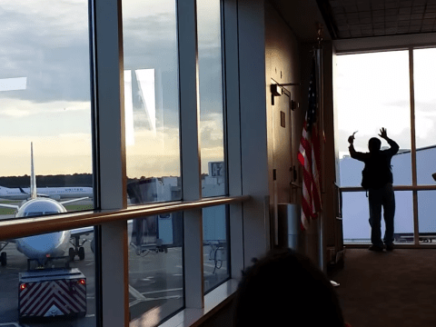 Couple miss their flight, bang on airport window to try and get the pilot's attention