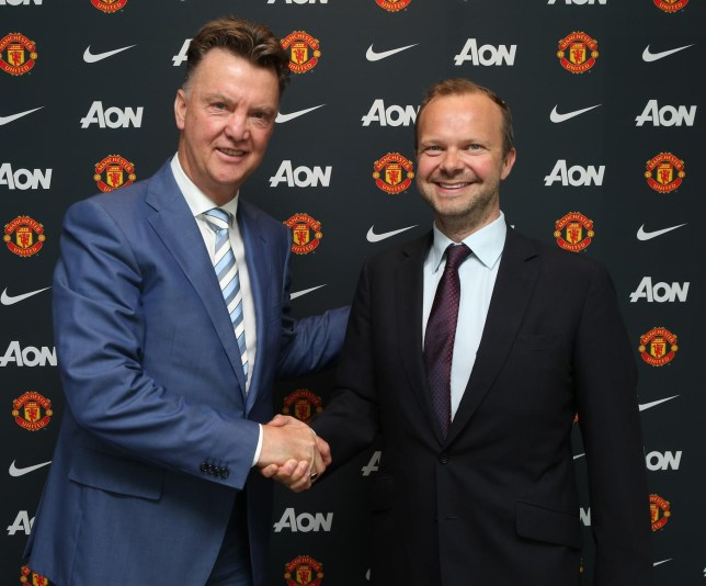 MANCHESTER, ENGLAND - JULY 16: (EXCLUSIVE COVERAGE) (MINIMUM FEES APPLY -250 GBP PRINT & 125 GBP ONLINE OR LOCAL EQUIVALENT, PER IMAGE) New manager Louis van Gaal (L) of Manchester United poses with Executive Vice Chairman Ed Woodward as he starts his new role at Aon Training Complex on July 16, 2014 in Manchester, England. John Peters/Man Utd via Getty Images