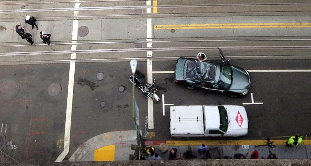 Window washer survives after falling 11 storeys and landing on moving car