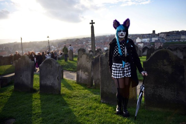"""TOPSHOTS A woman dressed in a costume is pictured during the biannual """"Whitby Goth Weekend"""" (WGW) festival in Whitby, Northern England, on November 2, 2014. The WGW festival brings thousands of goths and alternative lifestyle fans from the UK and around the world over a weekend of music, dancing and shopping.  AFP PHOTO / OLI SCARFFOLI SCARFF/AFP/Getty Images"""