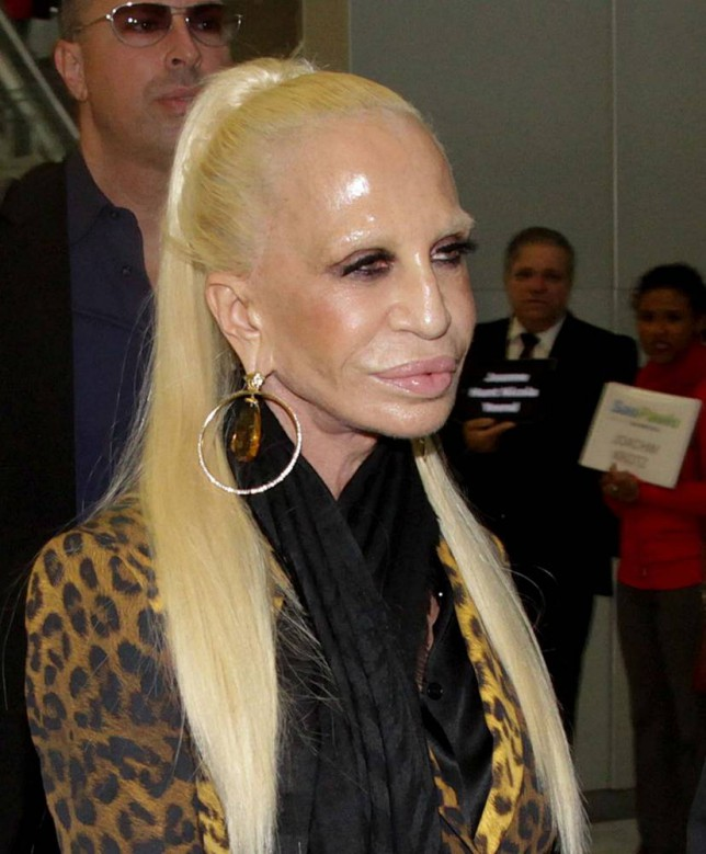 0ed0443d1a28f Donatella Versace looks like she s melting as she arrives in steamy ...