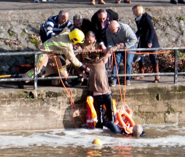 See SWNS story SWRESCUE: A woman who jumped into the River Avon to save her dog and was rescued by a passer-by remains seriously ill in the Royal United Hospital. The woman, beleived to be in her 80s, had jumped into the freezing river near Pulteney Weir to save her Jack Russell, when she got into difficulty.  A 55-year-old man, who was walking along the river, also jumped in to help her. Crews from South Western Ambulance Service and Avon Fire and Rescue attended the scene and had to use specialist equipment to rescue the trio. Eyewitnesses said emergency services struggled to get the man and woman out of the water.