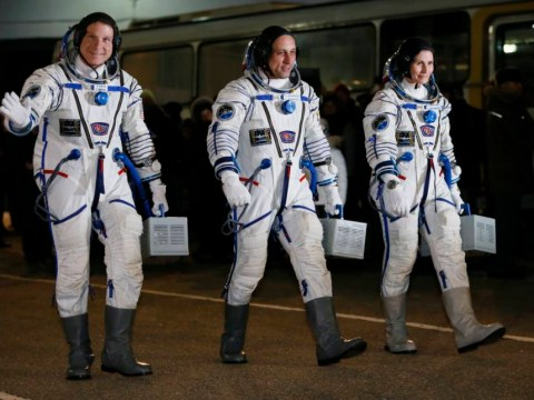Astronauts dock with International Space Station after six-hour flight
