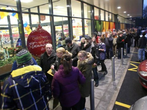 Hundreds queue outside an Aldi store for 'golden tickets'