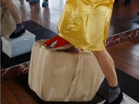 Man lifts 80kg of bricks with his testicles, swings them around