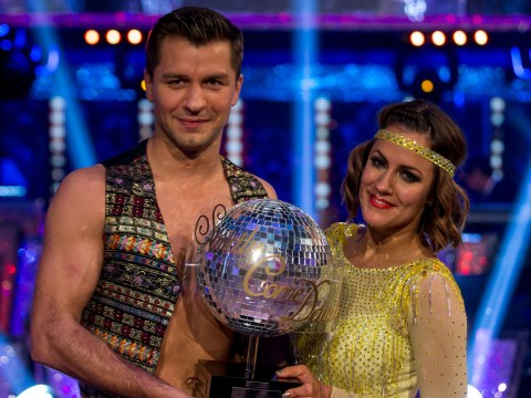 Strictly Come Dancing 2014 winner Caroline Flack snuggles up with trophy