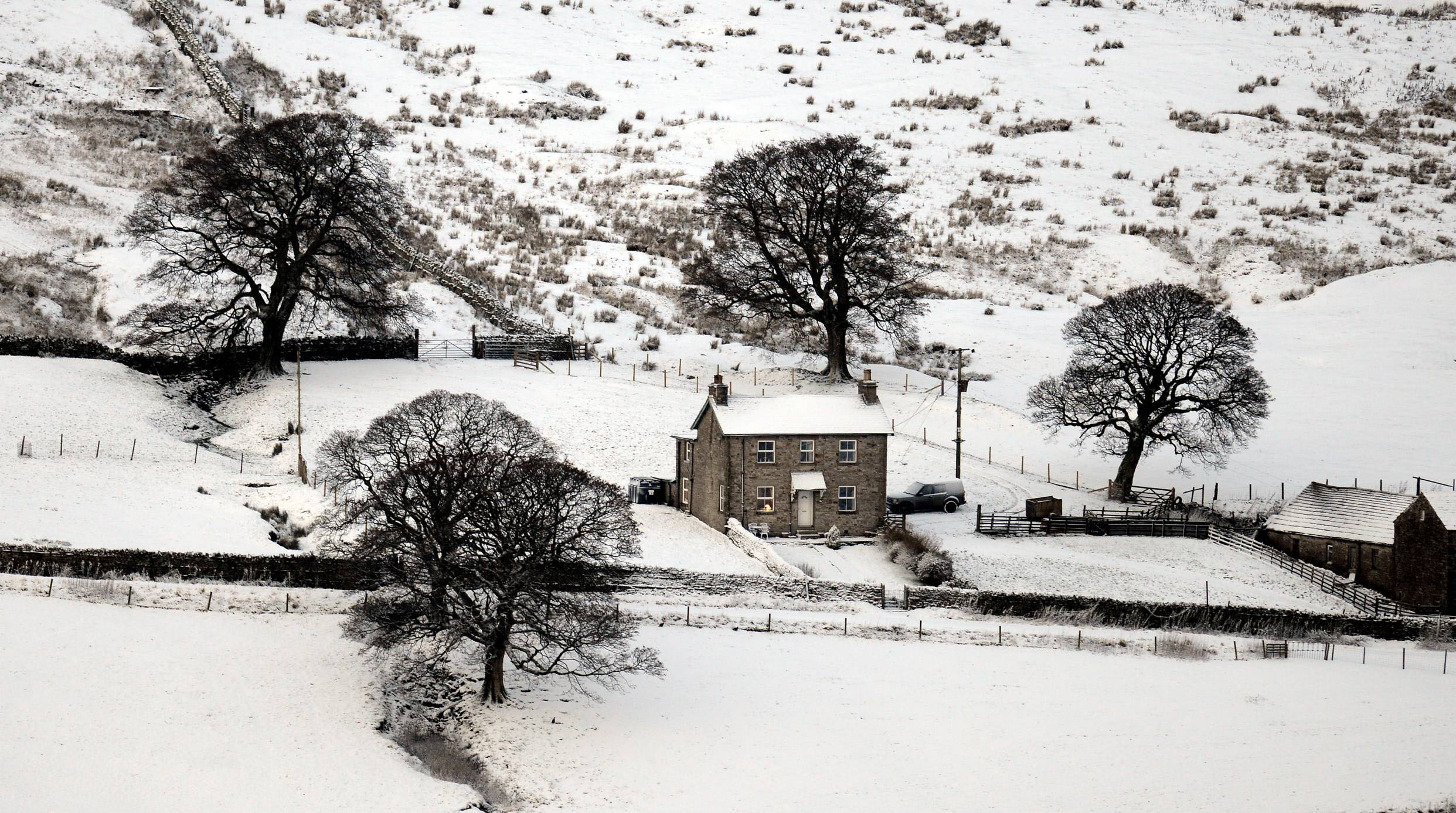 A farmhouse this morning (MON) as a beautiful winters day starts across the North Pennines in Cumbria following heavy snow showers overnight.