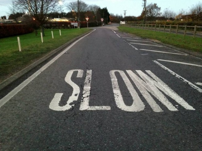 """Motorists have been left scratching their heads after a white road sign appeared saying SLOM - instead of SLOW. See MASONS story MNSLOW; The four-foot high word - which is Croatian for 'breakdown' - is on a slip road next to an industrial estate in Risby, Suffolk.It is not clear who has painted it as Suffolk County Council and the Highways Agency deny they are responsible. Local parish councillor Julian Read said: """"It is very unfortunate that a mistake has been made."""