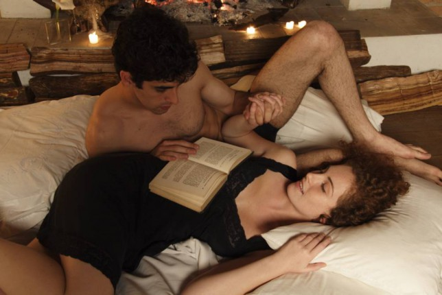 A couple read a book together