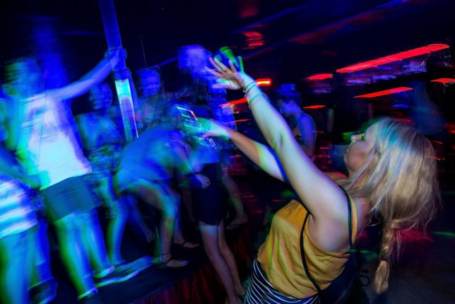 """KUTA, INDONESIA - NOVEMBER 25:  A girl dances in a nightclub during Australian """"schoolies"""" celebrations following the end of the year 12 exams on November 25, 2013 in Kuta, Indonesia. Every year over 3000 students descend on destinations such as Bali, Thailand, Fiji and Cambodia to celebrate 'Schoolies Week', which marks the end of the school year. Destinations such as Kuta in Bali are often chosen because of cheap alcohol and all night parties.  (Photo by Agung Parameswara/Getty Images)"""