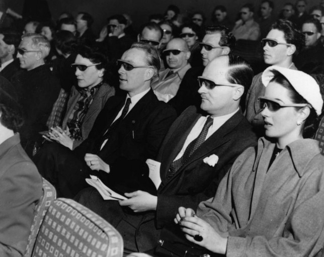 Cinema-goers wearing 3D glasses at a special Festival of Britain three dimensional film screening.    (Photo by Hulton Archive/Getty Images)