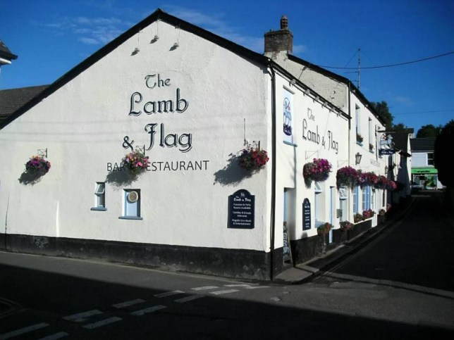 """The Lamb and Flag in Ottery St Mary, Devon, which has been hired by a kind hearted window so she could lay on a Christmas lunch for herself and up to 50 lonely strangers - so they all have company over the festive season. A kind-hearted widow has hired a pub to lay on Christmas lunch for herself and up to 50 lonely strangers - so they all have company over the festive season.See swns story SWLUNCH. The generous mystery benefactor - who has asked to remain anonymous - has reserved every table and will foot the estimated £1,000 bill for the turkey dinners plus wine. Aged 86, the woman lost her husband 12 years ago and has found herself alone over Christmas in recent years due to a lack of close family and an inability to travel. This year she was determined not to eat by herself again and has booked out a 50-cover pub and extended an open invite to people who would otherwise be on their own. The Oxford graduate, who does not know many people will take up her generous offer, said: """"I decided on the spur of the moment. """"I've been watching programmes on television about food banks and people by themselves being in trouble. """"Every time my post comes there is a request for money, and I thought rather than send the money abroad, why not help local people? """"Usually I send money to charities at Christmas, but rather than do that this year I thought about something local. The former Italian and French secondary school teacher, who doesn't have any children, added: """"I don't have any close relatives at all. I was an only child, my husband was an only child, and we live miles away from other relatives. """"My nearest relatives at the moment are in Derbyshire or Kent - a long way away."""" She has booked the mass lunch at the Lamb and Flag pub in Ottery St Mary, Devon, for anyone in the parish and the surrounding area. Along with a full dinner with all the trimmings, the generous pensioner has also ordered two bottles of wine for each of the 12 tables for the meal on December 23. At the"""