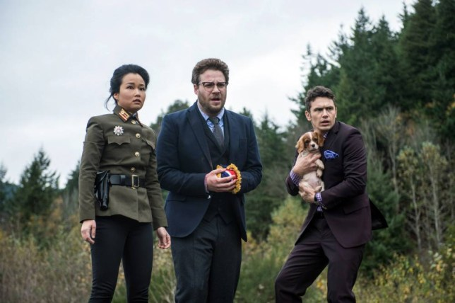 """This photo provided by Columbia Pictures - Sony shows, from left, Diana Bang, as Sook, Seth Rogen, as Aaron, and James Franco, as Dave, in Columbia Pictures' """"The Interview."""" When a group claiming credit for the hacking of Sony Pictures Entertainment threated violence against theaters showing ìThe Interviewî earlier this week, the fate of the movie was all but sealed. Even though law enforcement didnít deem the threats of violence credible, theater owners and Sony undoubtedly considered the 2012 massacre of a dozen people in a Colorado movie theater. That attack came without warning, and there was no precedent for such mass violence against a U.S. movie audience. (AP Photo/Columbia Pictures - Sony, Ed Araquel)"""